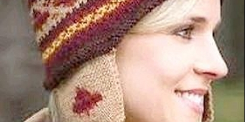 Як зв'язати шапку-вушанку спицями